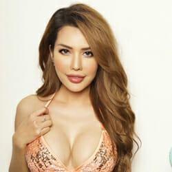 medium brown haired thai model pink sparkly bra