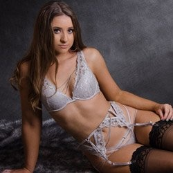 girl sitting with white lingerie