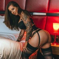 black stockings tattoos brunette