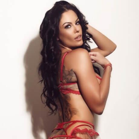 tattooed tanned brunette model